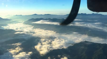 pervane : A view of the mountains from the porthole of an aircraft flying low in the Himalayas. Nepal. Stok Video