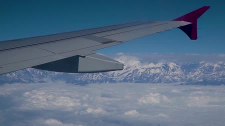 himalaia : View of the clouds and the Himalayas from the window of the plane. Journey to the Himalayan Mountains.