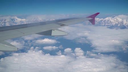 成層圏 : View of the clouds and the Himalayas from the window of the plane. Journey to the Himalayan Mountains.