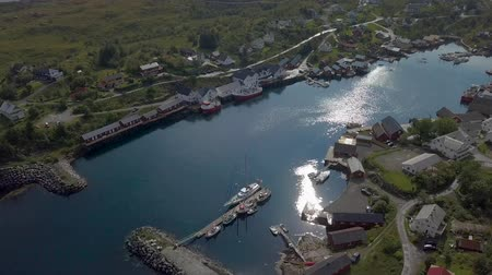 İskandinavya : Aerial view of the bay in a small fishing town in Norway. Sorvagen - fishing village on the lofoten islands, and popular tourist destination. 4k Stok Video