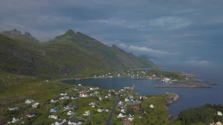Скандинавия : Aerial view of small fishing village before the storm. The Lofoten Islands. Norway 4k