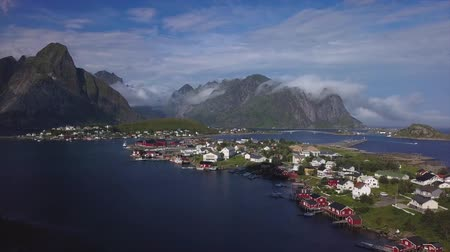 Aerial view of small village in Norway, Hamnoy. This is a small fishing village on the lofoten islands, and popular tourist destination with its typical red houses and natural beauty. 4k
