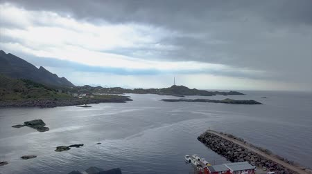Aerial view of sea bay, mountains and fishing lodges in the Lofoten Islands. Norway 4k Wideo