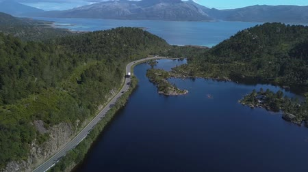 Aerial view of road by the lake, small house, fjord and mountains. Beautiful Nature Norway. Lofoten Islands. 4k 무비클립