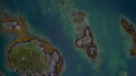 Flight over many small islands in the Norwegian Sea. Lofoten Islands. Norwey 4k Stok Video