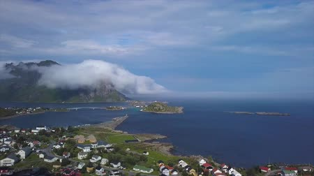 Panorama of the sea coast, beautiful mountains and small fishing villages. The Lofoten Islands. Norway 4k