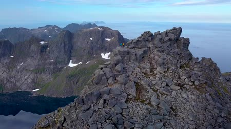 Aerial view of tourists on peak of a high mountain. Lafoten islands. Norway 4k Stok Video