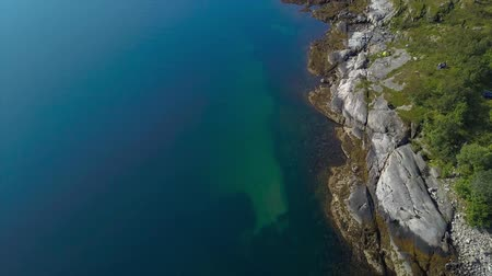 The Lofoten Islands. Flight over the rocky promontory and the sea. The Norwegian Sea. Aerial 4k 무비클립
