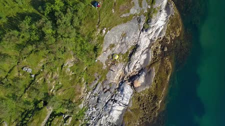 The Lofoten Islands. Flight over the rocky promontory and the sea. The Norwegian Sea. Aerial 4k Stock Footage