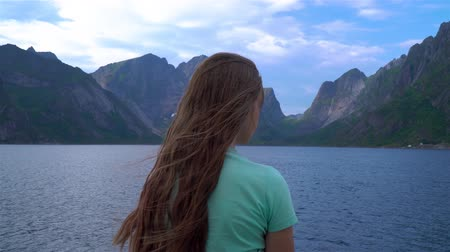 Portrait of a girl with long hair on a background of beautiful Norwegian nature Stok Video