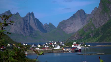 Hamnoy is village located on the Lofoten Islands in Norway. This is a small fishing village and popular tourist destination with its typical red houses and natural beauty. 4k Stock Footage