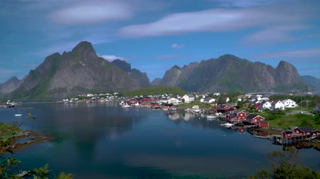 Hamnoy is village located on the Lofoten Islands in Norway. This is a small fishing village and popular tourist destination with its typical red houses and natural beauty. 4k Stok Video