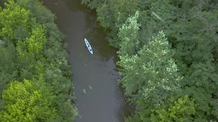 kano : Aerial view of kayak floats along a calm river among the trees