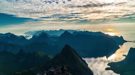 arquipélago : Timelapse View of moving clouds in the morning sky Above Fjord and Mountains. Lofoten islands. 4K