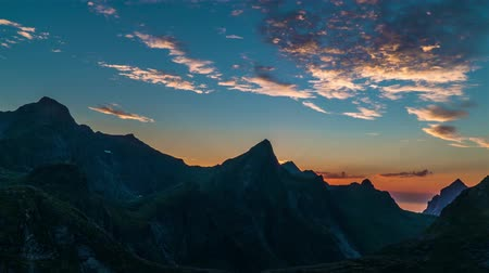 şiş : Timelapse View of moving clouds in the evening sky Above Norway Islands and Mountains. Panorama. Lofoten islands. 4K Stok Video