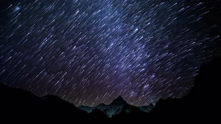 starlit : Time lapse of Star trails in the night sky. Starry night in the Himalayan mountains. 4K Stock Footage