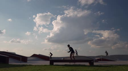 slalom : Time lapse Children to skate and rollerblades in the skate park Stock Footage