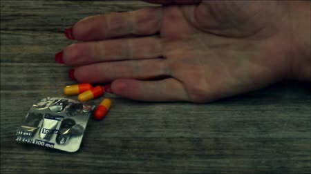 viciado : Overdose - pills in hand addict lying on the floor