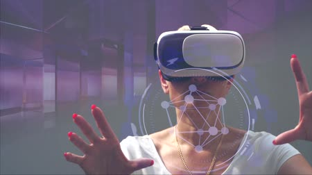 notion : Woman using virtual reality glasses with graphics effects Stock Footage