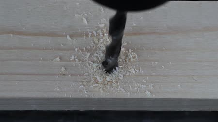 plywood : Man drilling the wooden plank