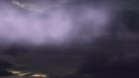 fenomen : Cinematic storm clouds with rainbow lightning strikes reflecting