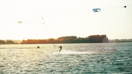 bátor : Wakesurfer surfing on board. Extreme life style