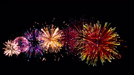 firecrackers : Bright grand festive fireworks on grade dark background. Beautiful flashes of fireworks in the sky. Stock Footage