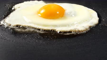 The egg is fried in a pan in melted butter. Fried eggs