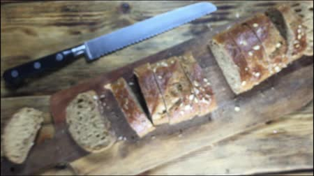 grzanki : Pieces Rustic bread with seeds fall on a wooden table