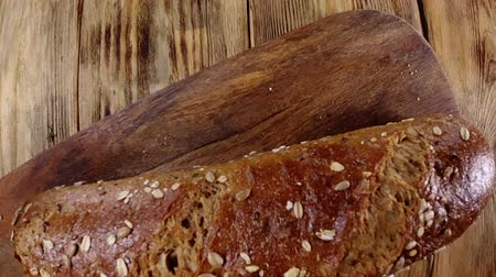 grzanki : Rustic bread with seeds fall on a wooden table
