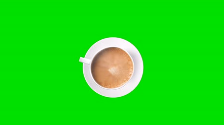 feijões : Top view. Cup of coffee with trickle of steam. Animated on green background
