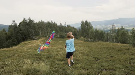 idaho : The boy runs and launches a snake in the mountains