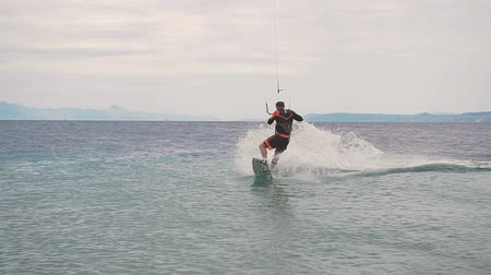 surfer paradise : Kite surfer rides on the waves of the Adriatic Sea. Croatian