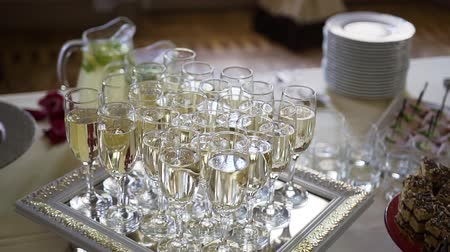 flet : Flute of cold white champagne or sparkling wine standing on the tray at a festive event or celebration