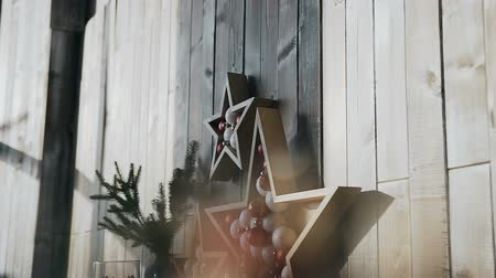 scrapbook : The original decor in the form of a wooden star hangs on the wooden wall of the cozy room