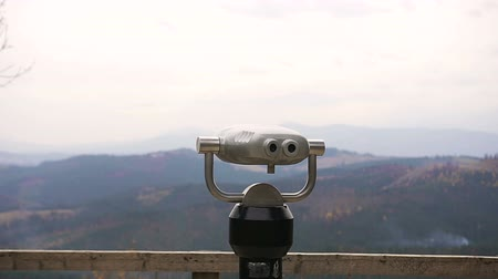 periscope : Tourist telescope look at mountains in the Bukovel. Coin operated binocular
