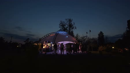 Beautiful wedding tent set up for an outdoor reception. This is a long night exposure in which many people entertain and dance