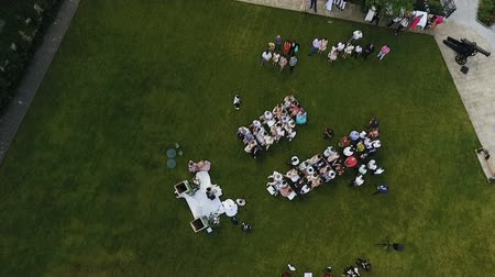 convidado : Wedding ceremony location with bride and groom, path between guests white chairs