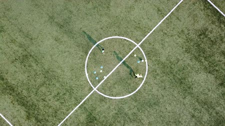playfield : Top view of football players during training.