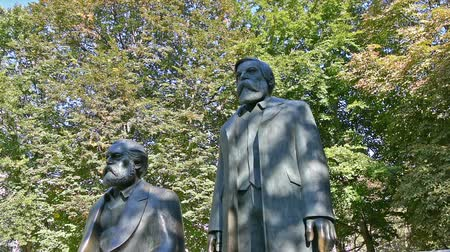philosopher : The statues of Karl Marx and Friedrich Engels in a park of Berlion