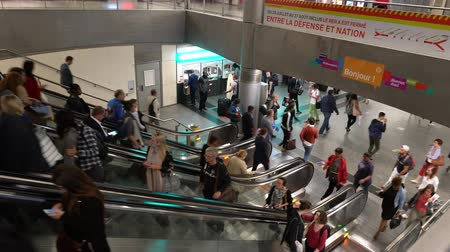 french metro : People climbing the escalator at the metro station in Paris Stock Footage