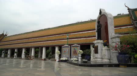 dev : A view of the courtyard of Wat Suthat temple in Bangkok, Thailand.
