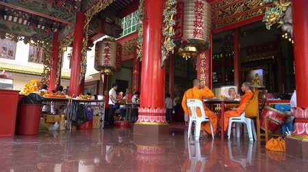 yaowarat road : some monks in the Chinese temple at Chinatown in Bangkok, Thailand Stock Footage