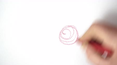 rabisco : drawing a scribble with a wax crayon on a white sheet of paper