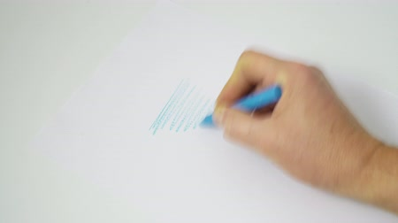 articles : a colored scribble on a white sheet of paper Stock Footage