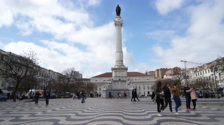 historical : People walking on Praca Dom Pedro IV also called Rossio in Lisbon, Portugal