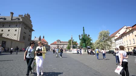 red square : Tourists walking on the Hradcanske Namesti in Prague, Czech Republic Stock Footage