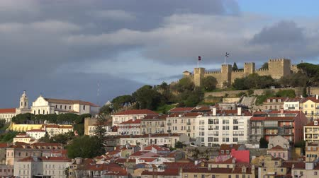 alfama : Aerial view of St. George Castle and the roofs of the city in Lisbon, Portugal Stock Footage