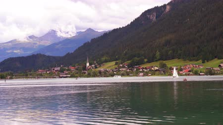 kamış : Some boats on the Weissensee lake, Carinthia, Austria Stok Video