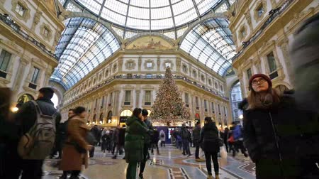 milan fashion : time lapse of people walking during Christmas holidays in Vittorio Emanuele II gallery in Milan Stock Footage